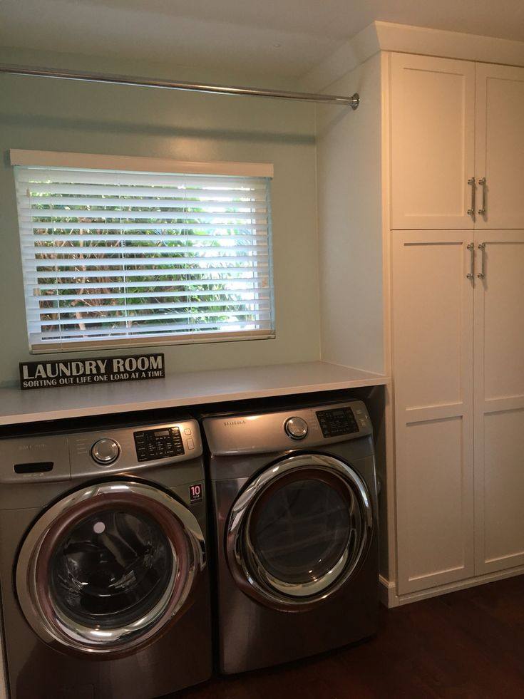 31 best laundry room images on pinterest flat irons for Laundry room countertop over washer and dryer