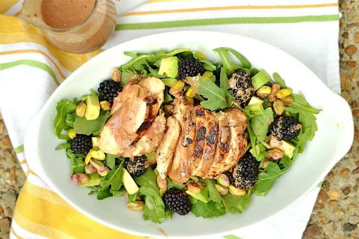 Grilled Chicken and Blackberry Salad is layered with fresh salad greens, luscious blackberries, pistachios, sliced avocado, and a sweet blackberry balsamic vinaigrette. A simple salad bursting with summer flavor! This recipe developed over a craving I had while shopping in Trader Joe's the other day (BTW: after living in Germany for 4 years it feels... Get the Recipe