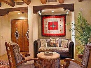 """Hacienda & Spa at Hotel Santa Fe ... gas log kiva fireplaces in every room - personally assigned butlers ... you may even see a movie star in the breakfast lounge (Nick Nolte and family - filming """"Rediculous Six"""" with Adam Sandler, Feb-May, 2014)."""