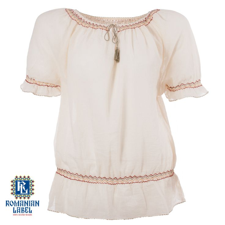 $49.24 A 100% hand made traditional blouse, exclusively tailored out of natural materials, such as ivory cotton, yellow, green and red embroidery.
