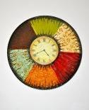 PRICE REDUCTION!! WALL CLOCK. Colorful, cool wall clock from Pier 1.  Excellent condition. Battery operated.