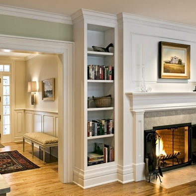 bookshelves all the way to ceiling next to fireplace...add lower cabinets (glass-front, maybe?!)