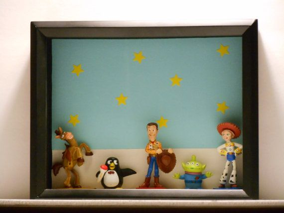Hey, I found this really cool disney shadow box at ANJ Customs its an  Etsy listing at https://www.etsy.com/listing/182367814/toy-story-2-shadow-box