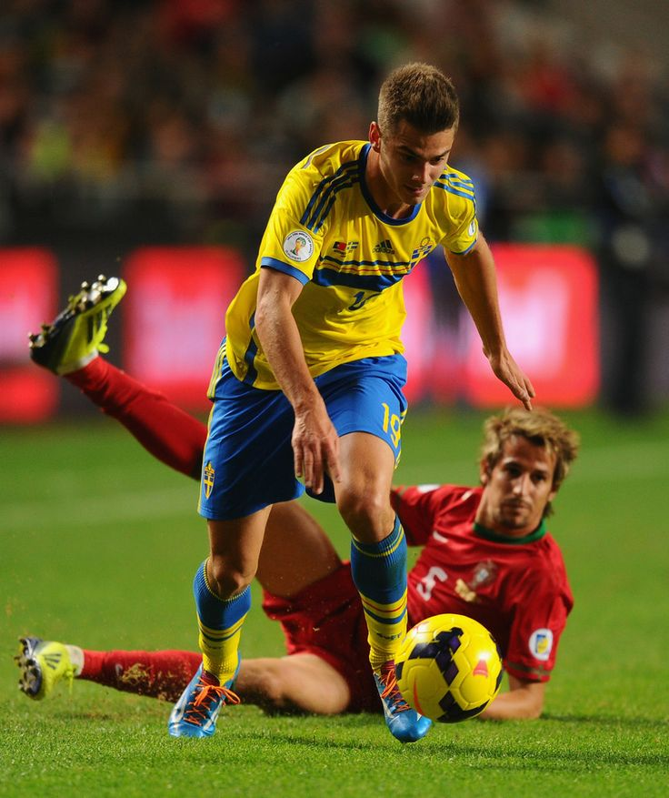 Alexander Kacaniklic of Sweden gets past Fabio Coentrao of Portugal during the FIFA 2014 World Cup Qualifier Play-off First Leg between Portugal and Sweden at Estadio da Luz on November 15, 2013 in Lisbon, Portugal.