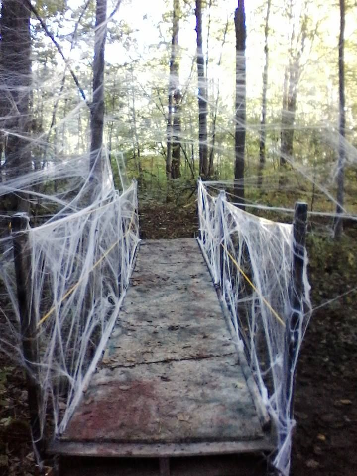 "Bridge for Halloween yard haunt, spider webs all around it. Build a solid structure with no give in the walkway. then cover with 1"" foam from the local fabric store. Cover the foam cushion with your catwalk slats..."