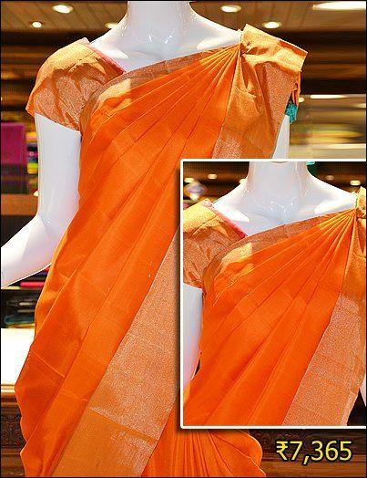 Look angelic dressed in this trendy orange mayuri soft silk saree with heavy zari border.