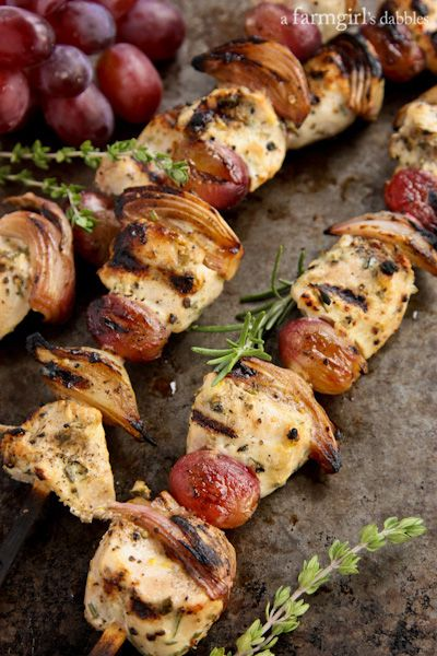 Herby Grilled Chicken Kebabs with Grapes and Shallots - afarmgirlsdabbles.com #chicken #kebabs #grilling