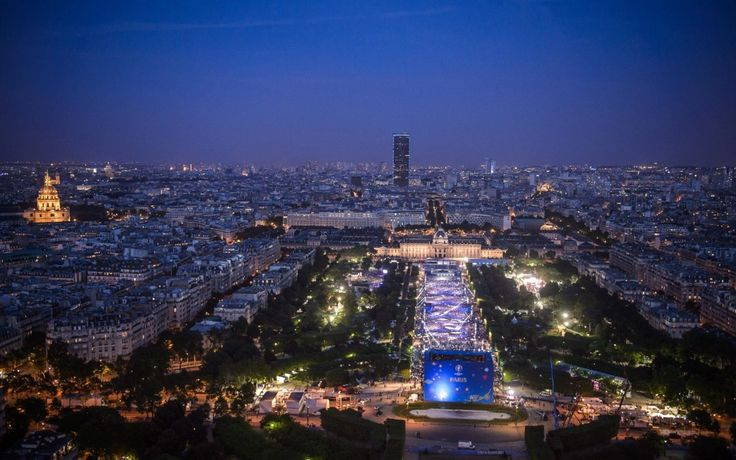 General view of fans gathering at the UEFA EURO 2016 Fan Zone at Champ de Mars near the Eiffel Tower to attend a concert of French DJ David Guetta as part of the EURO 2016 pre opening show in Paris, France. The UEFA EURO 2016 soccer championship takes place from 10 June to 10 July 2016 in France.