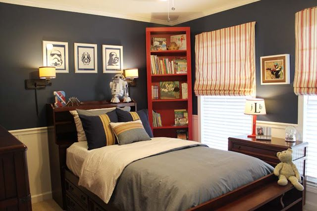 Like the navy, the DIY chair rail, the red bookcase.  A Star Wars Themed Big Boy Room - Southern Revivals