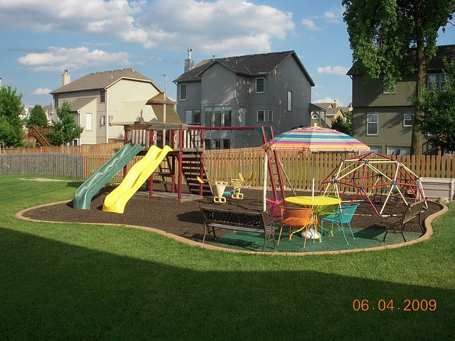 backyard play area mulched in yard patio and by yard
