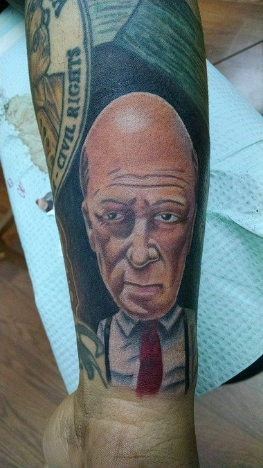 A caricature of suspenders-clad meteorologist James Spann is tattooed on this Birmingham man's arm.