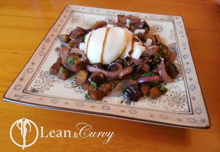 Recipe from Getting Lean and Curvy - Poached Eggs on a delicious bed of Eggplant (aubergine), Spanish Onion Rings and Italian Parsley - finished off with an artistic splash of Balsamic Vinegar Glaze.  I also added mushrooms, fresh oregano and a splash of verjuice for some extra zing. Delicious breakfast!