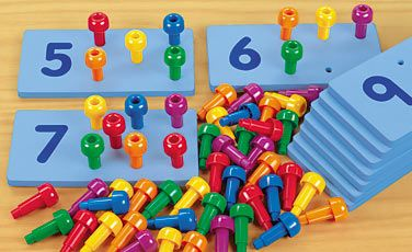 """Peg Number Boards    As kids fit 9 pegs into the """"9"""" board and 3 pegs into the """"3"""" board, they get tons of hands-on counting practice—and learn to associate numbers and quantities. Our set includes 10 soft and quiet foam rubber boards and 60 giant, easy-grip plastic pegs. Each board measures 4"""" x 8"""".    Targets standards in these areas:  • Identifying numbers  • Relationship between numbers & quantities  • Counting with objects TT625 • $34.95"""