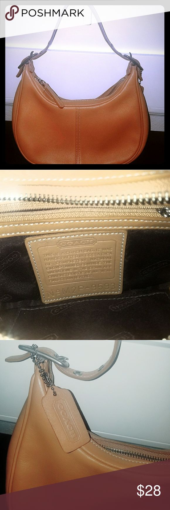 """Genuine Small Coach Leather Handbag - Color is Tan Small Tan Genuine Leather COACH purse. Almost perfect condition approx. 8"""" (L) x 5"""" (H). Kept in smoke free home in a coach duster bag. Although it is several years old, I rarely used it. Great for nights on the town and day trips/outings when you can get away with having the bare necessities in your purse. I purchase all of my handbags from either Nordstrom or the actual designer store. It's really too cute, classy and a steal for $28 as I…"""