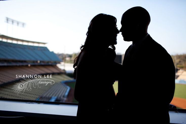 Pursued by the Player - the kiss - (baseball themed engagement session)