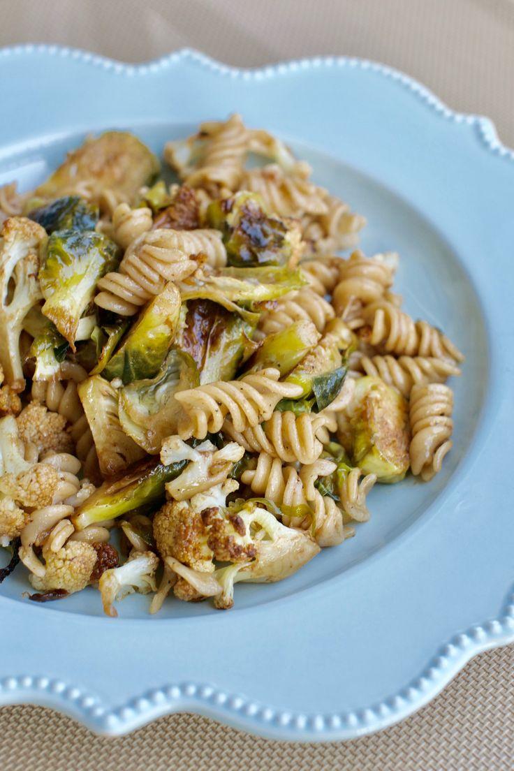 Gluten Free Quinoa Pasta with Roasted Brussel Sprouts and Cauliflower with a Balsamic Glaze. #pasta #glutenfree #vegan #vegetarian #roastedveggies #roastedvegetablepasta