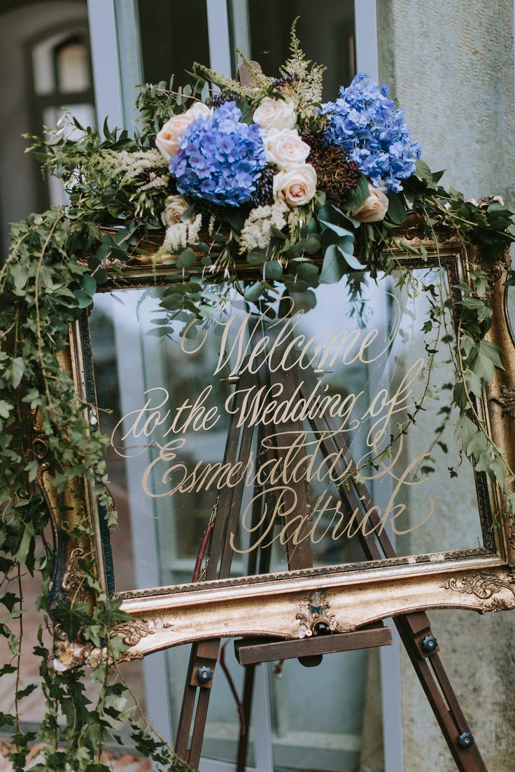 Gold Guilt Mirror Wedding Sign Decorated with Flowers - Pastel Blue Outdoor Wedding in Germany Planned & Styled by A Very Beloved Wedding | Photography by Thomas Steibl