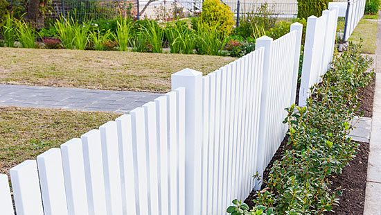 A white picket fence can add a classic look to your home