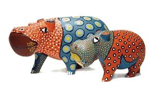 Playful hippos made from Jacaranda wood #africa #animals #sculpture