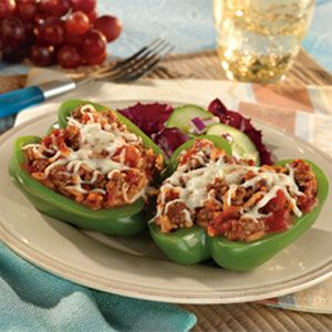 Good-For-You Stuffed Peppers - only 5 ingredients - rice, ground beef, pasta sauce in peppers and topped with cheese