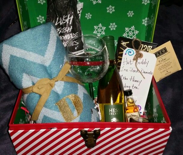 Adult Christmas Eve Box....monogram throw, wine and wine glass, dark chocolate, Lush bath bomb, and Hot Toddy ingredients (honey Jack Daniel, honey, and tea). Merry Christmas!!!!
