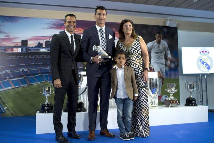 MADRID, SPAIN - OCTOBER 02:  Cristiano Ronaldo (2ndL) poses for a picture with his trophy as all-time top scorer of of Real Madrid CF with his son Cristiano Ronald JR, mother Maria Dolores dos Santos and his manager Jorge Mendes (L) at Honour box-seat of Santiago Bernabeu  Stadium on October 2, 2015 in Madrid, Spain. Portuguese palyer Cristiano Ronaldo overtook on his last UEFA Champions League match against Malmo FF Raul's  record as Real Madrid all-time top scorer.  (Photo by Gonzalo…