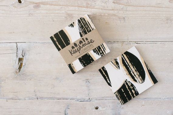 """Measuring 4"""" by 4"""", these black and white Drops patterned birchwood coasters are handmade in Nova Scotia. Water resistant and food safe, they are perfect for protecting surfaces. Find table linens, tea towels and serving trays in coordinating patterns and colour ways at keephousestudio on Etsy"""