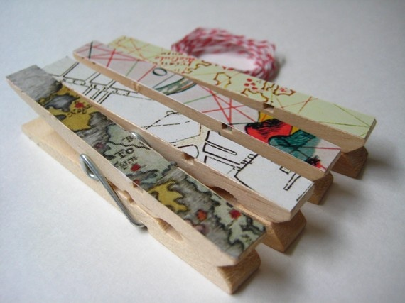 map + clothes pins - I'd also add a magnet to the back of the pin for fridge use