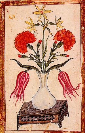 Some of the illustrations in the Gaznevi Album are in a mixed technique of painting, collage and cut-paper work, their materials including coloured paper and sequins. This example is a composition of flowers beneath a scrollwork floral bower. The fritillaria in the centre is a rare example of this flower in the art of decoration. Gaznevi Album.  ISTANBUL UNIVERSITY LIBRARY.