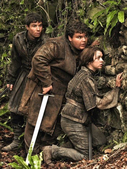 Gendry, Hot Pie and Arya. And what genius gives the sword to Hot Pie?