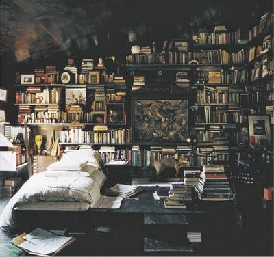 A library bedroom...It would be awesome to sleep in there.  Oh and imagine naps during a thunderstorm surrounded by books.  My kind of heaven.