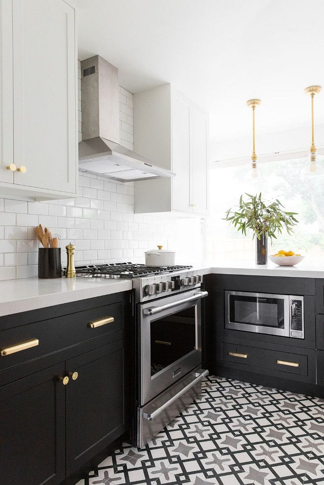 Beautiful two-toned kitchen with black and white cabinets and cement tile. Studio McGee. Home Bunch blog