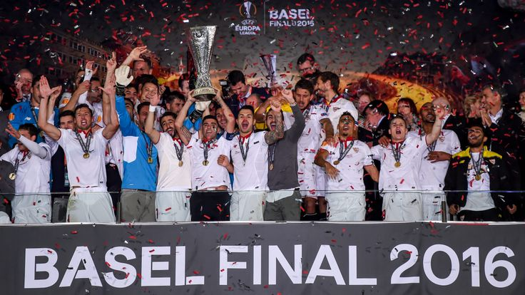 Sevilla players lift the cup after victory in their UEFA Europa League final match against Liverpool