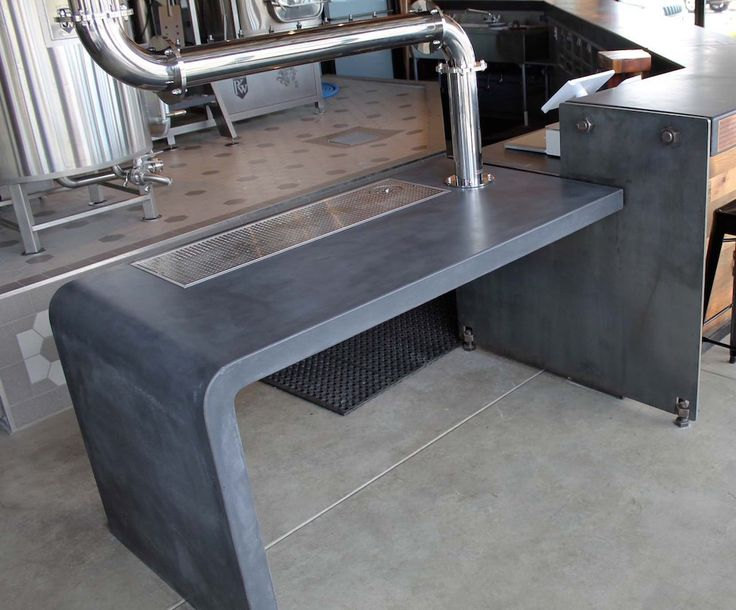 Industrial style concrete and steel service bar.