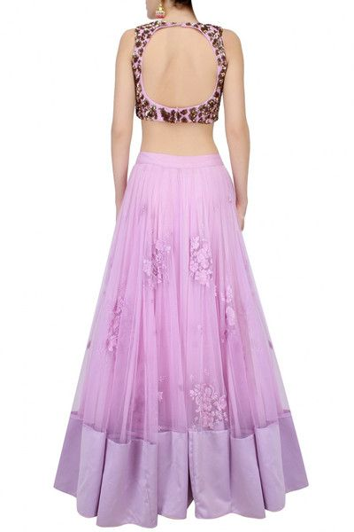 This set features a lavender lehenga in net base with floral thread work motifs scattered all over and a broad lavender silk border along the hem. #purplecolorlehengacholiwithsequinwork