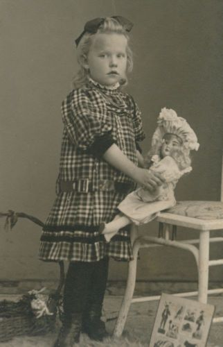 LITTLE-GIRL-with-NICE-DOLL back in the day dolls were very important to girls-Germany-c-1910-