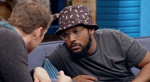 Lessons Schoolboy Q on the couch in Specs and a Bucket Hat