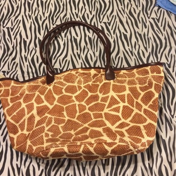 Giraffe print woven beach bag. Previously loved beach bag. Has signs of wear but is still a great bag for chilling on the beach. Charming Charlie Bags