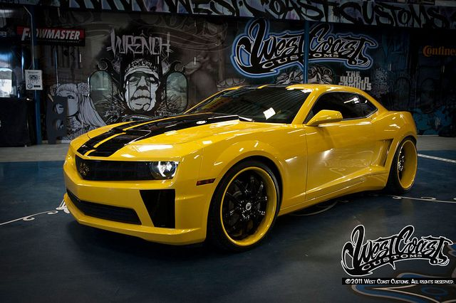 Yellow Camaro This is the car I want. Only because my nephew says it is coooool. He always wants me to take a picture when he sees one.