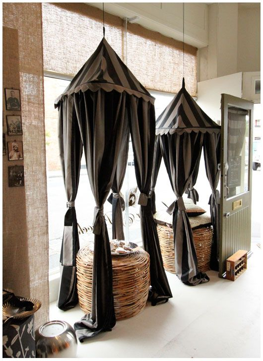 circus canopies possibly in all black for part of a haunted carnival theme or party theme for the Night Circus