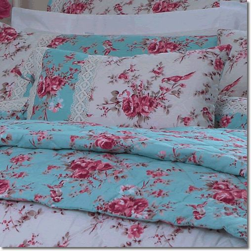 Dorma Mirabelle Boudoir Cushion - This beautiful new design by Dorma is filled with bright fuchia roses on a duckegg blue background perfect for the summer season, suitable for both traditional or modern rooms.