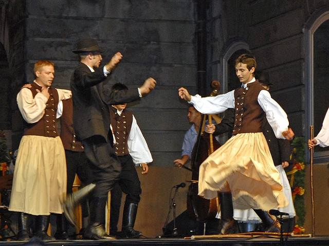 Some Hungarian men wearing the traditional dresses while dancing - dalbera's image
