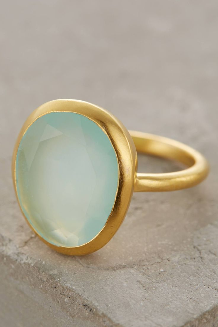 I love this ring but mine has turned to silverish the brass has faded.  Seastone Ring - anthropologie.com