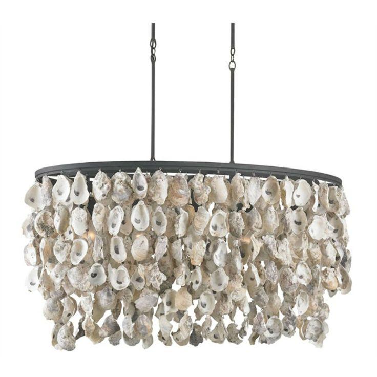 coastal style lighting. shells thoughtfully hung along the blacksmith finished wrought iron framework casting a warm ambiance through veil of this light reminds coastal style lighting