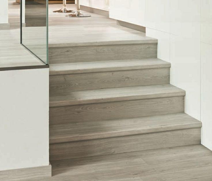 Suelo laminado de quick step con perfil incizo 5 en 1 los for Pisos de madera color gris