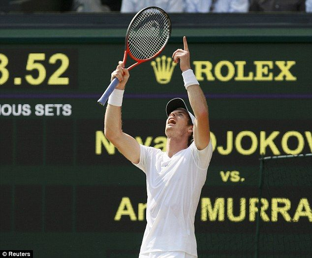 Murray celebrates winning the first set on the way to his historic victory