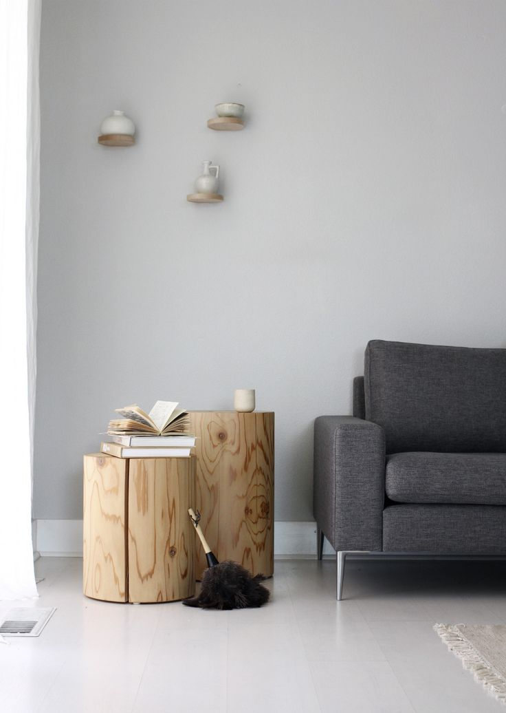 Blocks of wood make up these gorgeous tables, ideal for warming up an otherwise cool toned space.