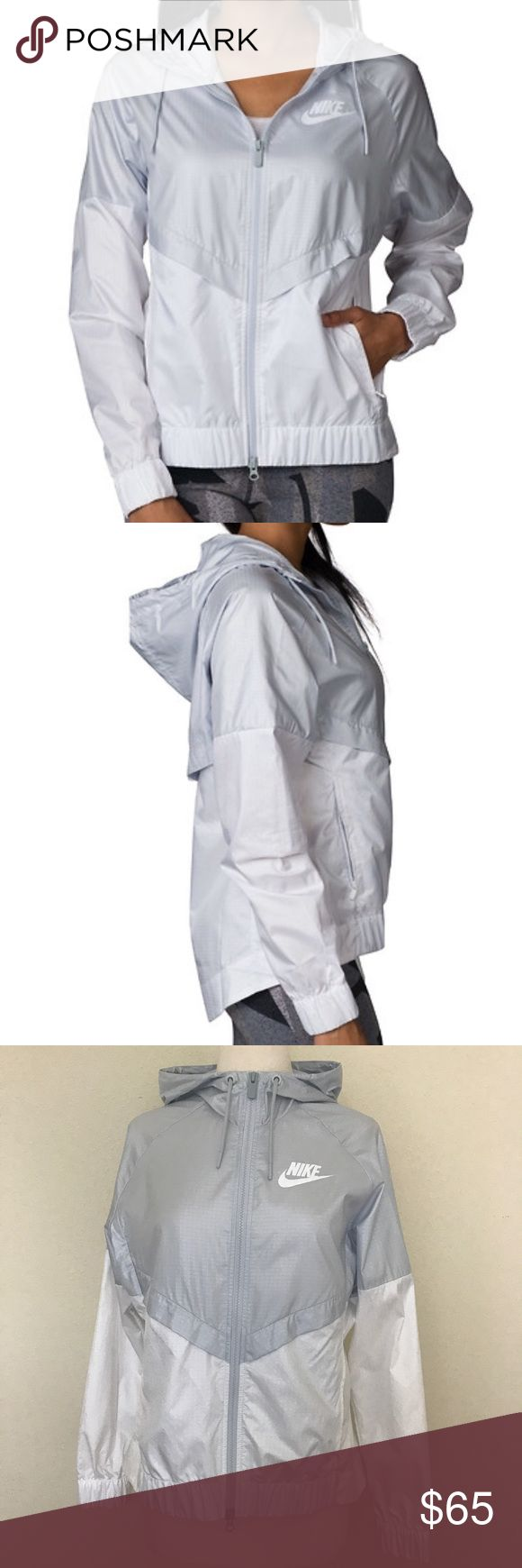 Nike Windrunner Jacket Talk about gorgeous! This Nike features a platinum and white color black, elastic front shirttail back, stringed hoodie, zip pockets, zip up the front, mess back under the rain flap and in perfect NWT's condition LXD8/9 gorgeous!!!! Nike Jackets & Coats