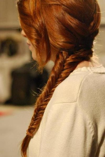 long curled hair in a loose fishtail braid / plait