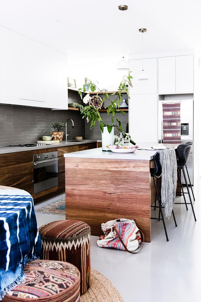 Amelia's husband Thomas built the kitchen using blackbutt timber salvaged during the renovations. The benchtop is Caesarstone and the tiles are from Di Lorenzo.